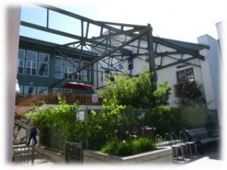 Swan's Market Cohousing. Ground level view of the central walkway, piazza, and gardens.